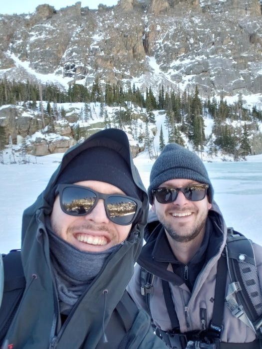 Two brothers taking a selfie in the mountains