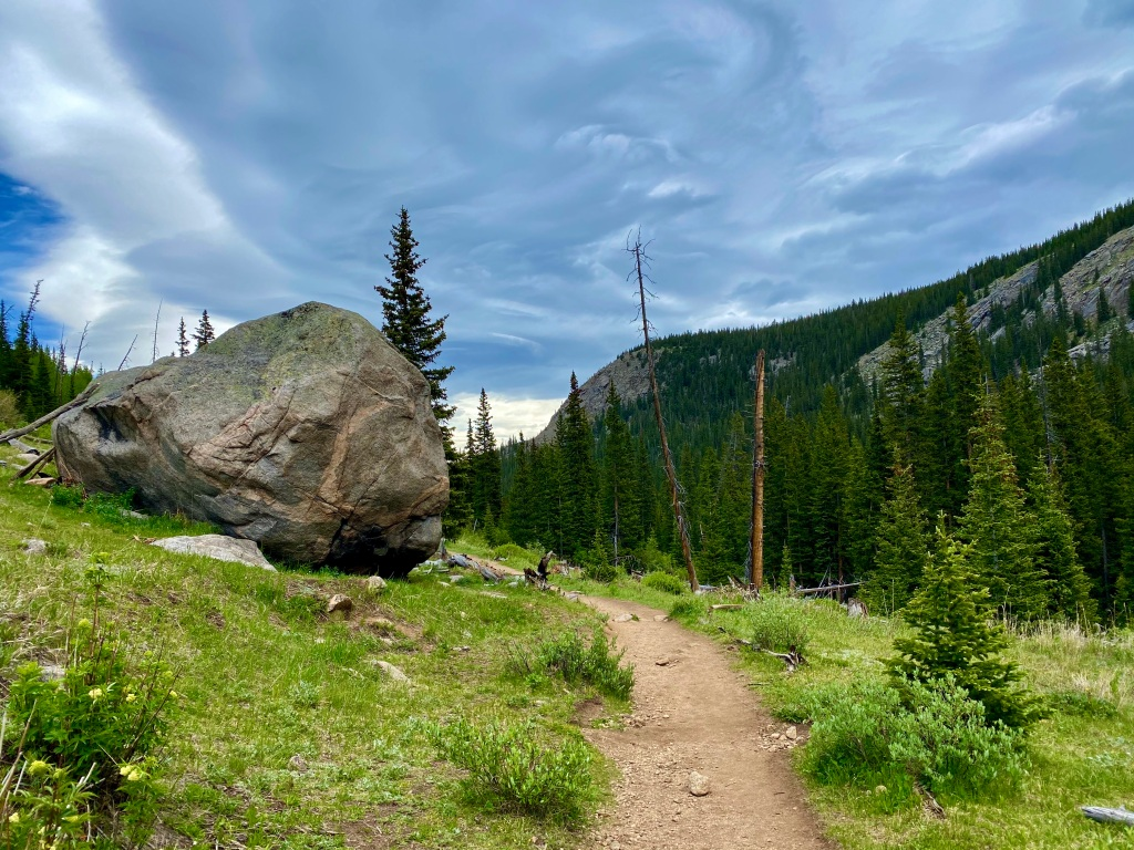 Giant boulder next to the hiking trail