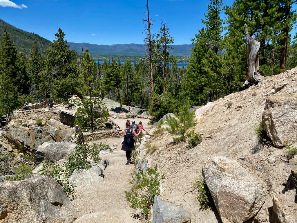 Family hiking down Rocky Mountain trail
